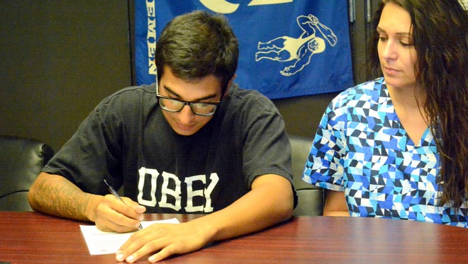 Carlsbad's Josh Chavarria signs his letter of intent Tuesday to play baseball at Cochise College in Douglas, Ariz.
