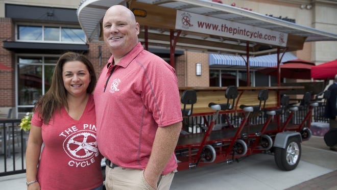 Lilia Hutchinson, and her husband Chris Hutchinson, who's the owner of The Pint Cycle, a newly started 16-person bicycle modeled after other area rigs that let participants ride around the downtown Fishers hub and try an expanding list of eating and drinking establishments, Tuesday, June 7, 2016.