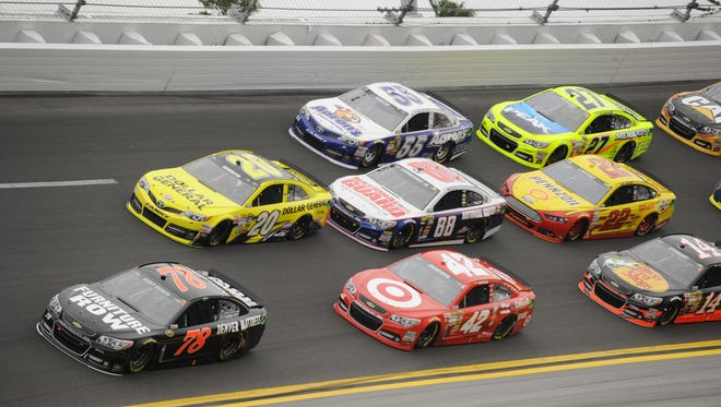 Cars go three-wide down the backstretch at Daytona International Speedway as they maneuver for position in last year's race.