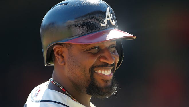 Atlanta Braves second baseman Brandon Phillips (4) smiles during a baseball game against the St. Louis Cardinals Sunday, May 7, 2017, in Atlanta. (AP Photo/John Bazemore)