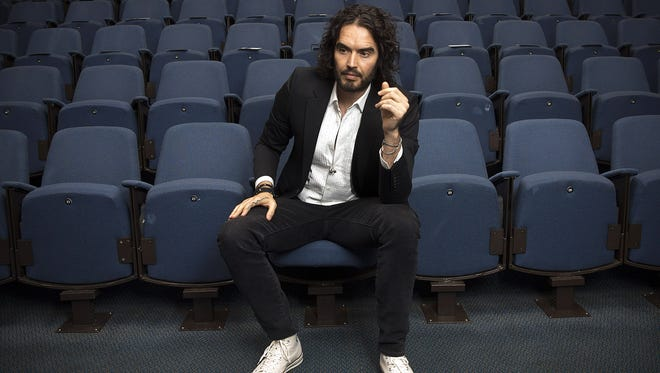 Russell Brand poses in London on Nov. 25, 2014.