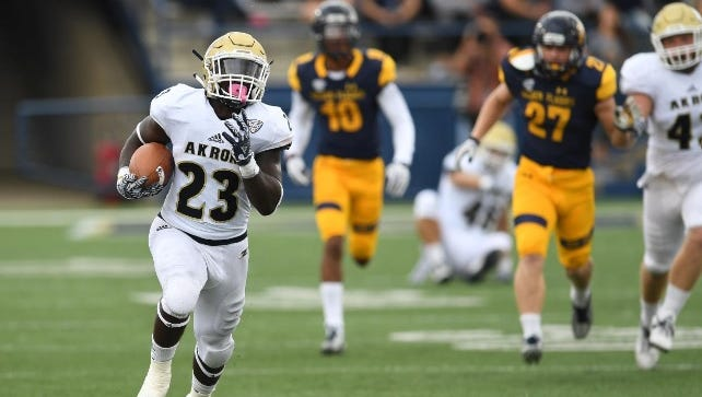 Akron running back Van Edwards rips off a big run during the Zips' 31-27 win over Kent State on Oct. 1