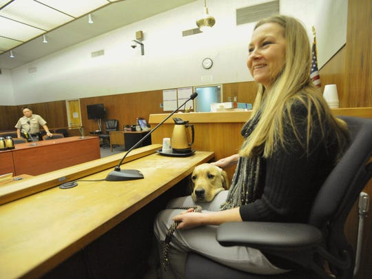 Renee Newman pretends to be a witness while Fortune shows how he comforts victims in court.