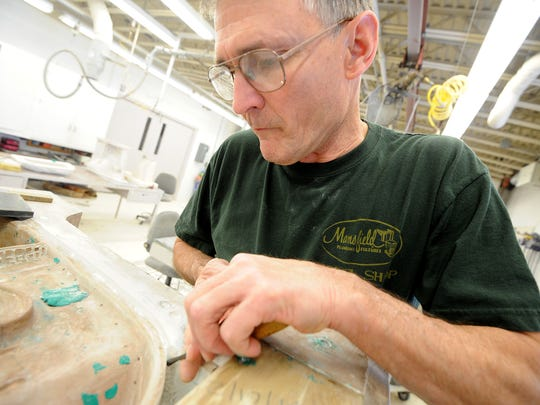 Dave Fletcher of Wooster create a mold Tuesday morning