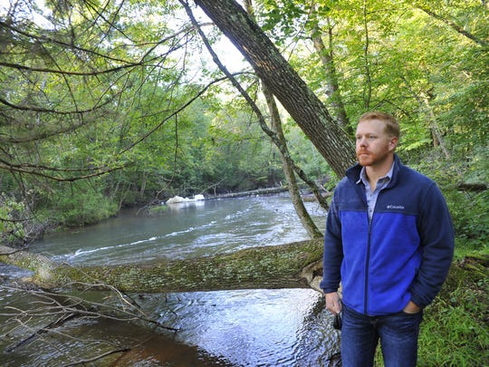 Ben Tilberg of Grand Rapids talks about his passion for canoeing at Four Mile Creek on Lake Wazeecha, and his efforts to clean the creek of fallen trees.