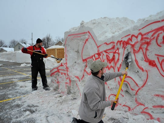 Sculptors work on a showpiece for the the seventh annual Souper Snow Sculpture Spectacular in 2012. This year's event will be Saturday, Jan. 24.