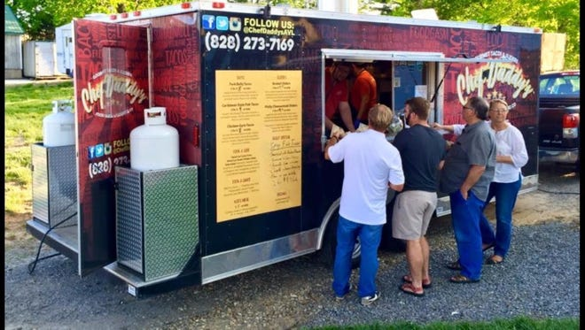 Customers line up at Chef Daddy's Food Truck. Owner Wesley Wright left his job as a chef in Asheville, North Carolina, to move to the Clemson area.