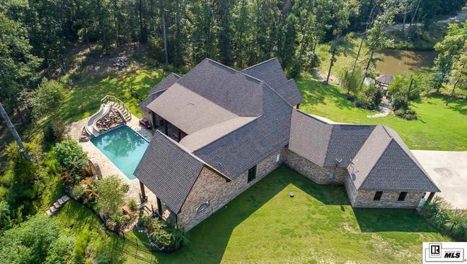 The home for sale at 342 Lea Drive offers 4.8 acres that border the D'Arbonne National Wildlife Refuge