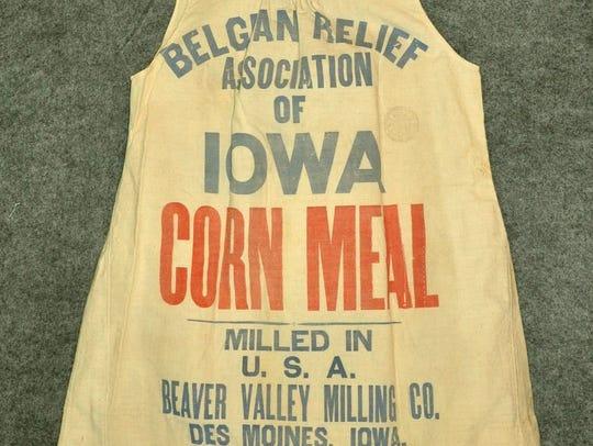 "Dress made from cornmeal sack. ""Belgian Relief Association"