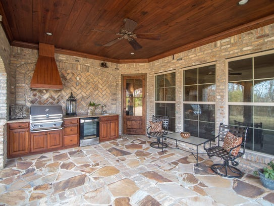 Enjoy outside living on the back porch loaded w/grill,