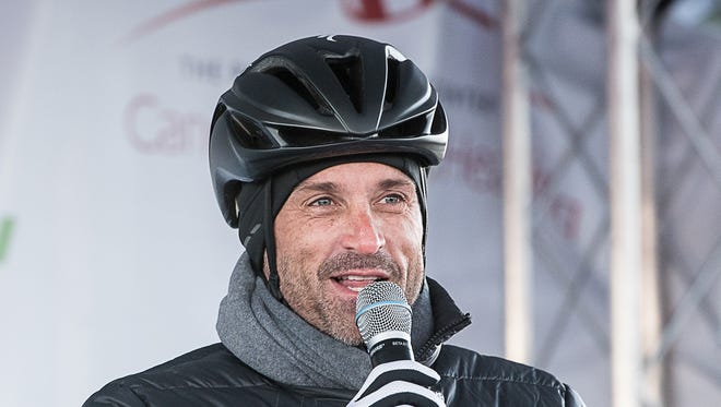 """Patrick Dempsey pumps up the crowd before a chilly start on the final day of the two-day bike-and-run fundraiser Sunday, Oct. 18, 2015, in Lewiston, Maine. The event is a fundraiser for The Patrick Dempsey Center for Cancer Hope & Healing at the Central Maine Medical Center. Dempsey is best known as a doctor nicknamed McDreamy on TV's """"Grey's Anatomy.""""  (Andree Kehn/The Lewiston Sun-Journal via AP) MANDATORY CREDIT"""