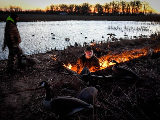 In the predawn, Greg Nunley (right) and Jonathan Dixon enter a goose blind on Nunley's farm off of J. Dance Road in eastern Henderson County Thursday, February 9 2017.