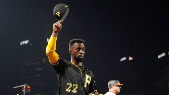 Pittsburgh Pirates center fielder Andrew McCutchen (22) tips his cap as he is removed from the game against the Baltimore Orioles during the seventh inning at PNC Park.