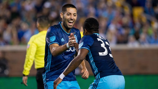 Seattle Sounders midfielder Clint Dempsey (2) celebrates his goal in the second half of Saturday's game against Minnesota. Seattle won 4-0 to stretch its unbeaten streak to seven games.
