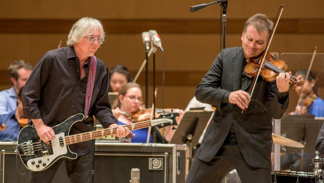 """Mike Mills, left, and Robert McDuffie will present their """"Concerto for Violin, Rock Band and String Orchestra"""" Nov. 5 at Carmel's Palladium."""