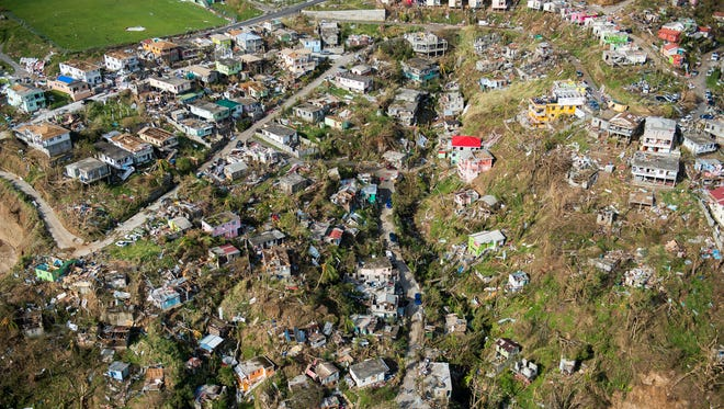 An aerial view of Roseau, capital of the Caribbean island Dominica, shows destruction, Thursday, three days after passage of Hurricane Maria. Dominica, located near the French islands of Martinique and Guadeloupe, has been almost completely cut off from the world since the impact of the hurricane.