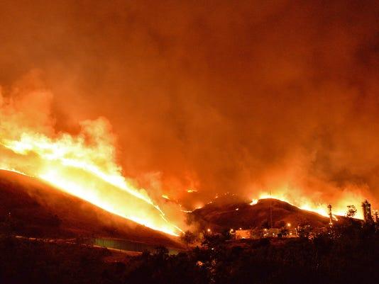 636017538000752111-Western-Wildfires-May.jpg