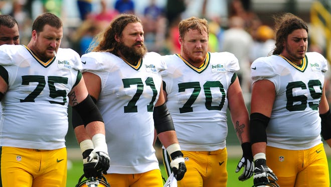 Green Bay Packers offensive linemen, from left, Bryan Bulaga, Josh Sitton, T.J. Lang, and David Bakhtiari, during training camp practice at Ray Nitschke Field, Monday, August 25, 2014.