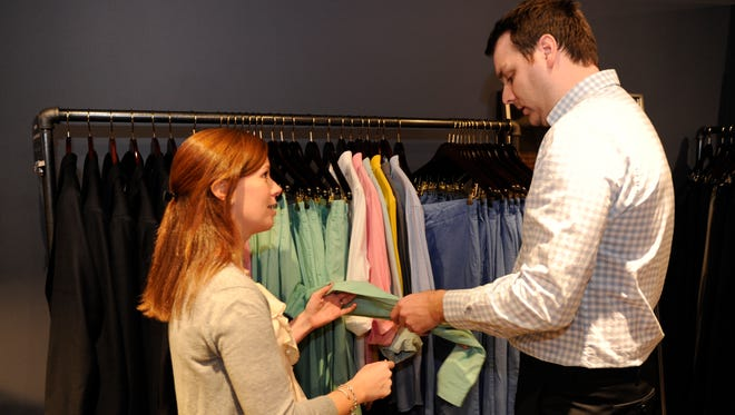 Katie Manning, assistant manager at Bonobos Guideshop in Georgetown, helps Brad Grayson with his shopping.
