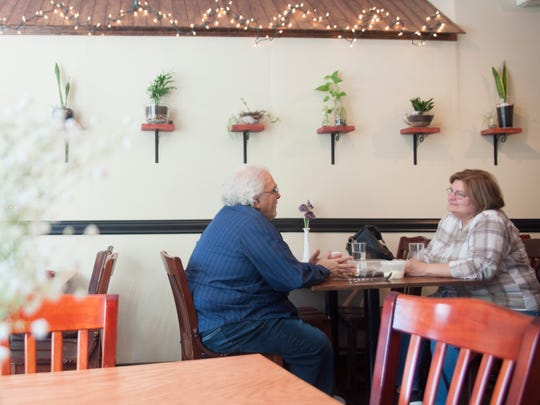 Guests enjoy a meal at the cozy Park Place Café & Restaurant in Merchantville, which features photos from the chef's nature walks and foraging adventures.