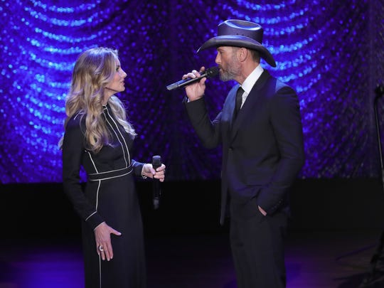 Singers Faith Hill and Tim McGraw, shown performing