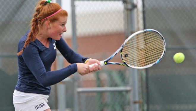 Cathedral's Maeve Koscielski returns the ball in play against North Central's Claire Reifes, during the girls tennis sectional at North Central vs Cathedral, Wednesday, May 20, 2015.