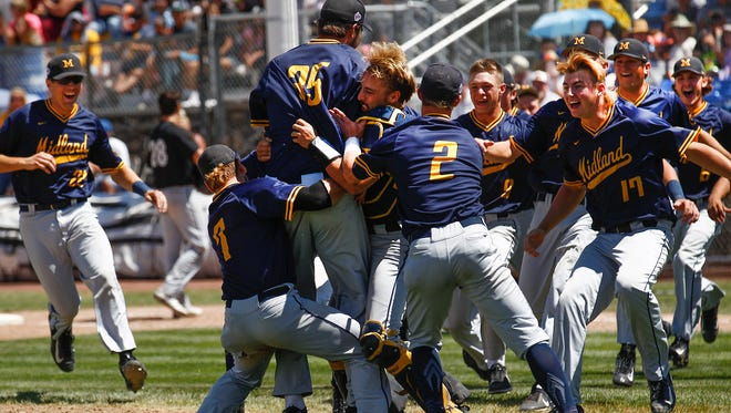 The Midland Redskins celebrate their victory over the Danville Hoots Sunday after the championship game of the Connie Mack World Series at Ricketts Park in Farmington.