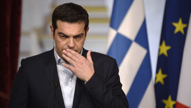 Greece's Prime Minister Alexis Tsipras delivers a speech at the Elysee presidential palace, on Feb. 4 in Paris.