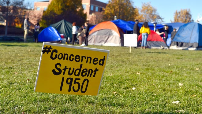 A sign is posted where student protesters have put up tents on the University of Missouri campus.