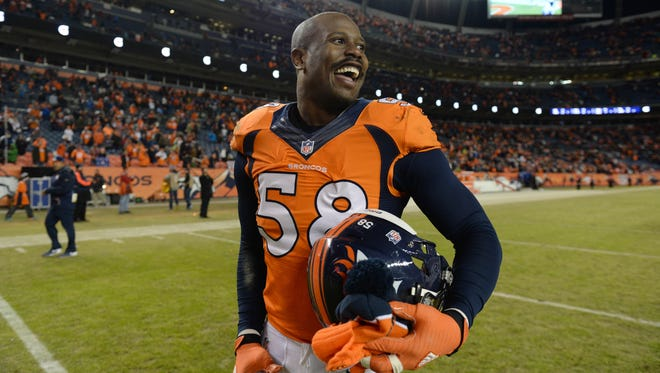 Denver Broncos outside linebacker Von Miller (58) celebrates the win over the San Diego Chargers at Sports Authority Field at Mile High.