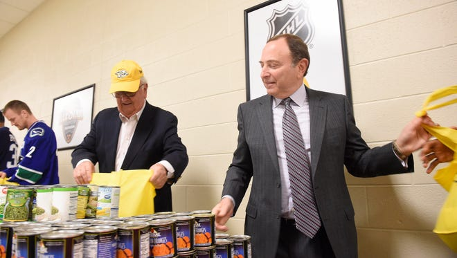 Chairman of the Board for Predators Tom Cigarran, left, and NHL commissioner Gary Bettman fill bags of food at the 2016 NHL All-Star Legacy Family Life Center, unveiling of 30,000-plus square feet of renovated space at the Nashville Inner City Ministry Jan. 29, 2016 in Nashville, Tenn.