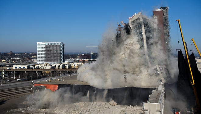 The LifeWay Draper Tower implodes across the street from the Frist Museum in Nashville, Tenn., Saturday, Jan. 6, 2018.