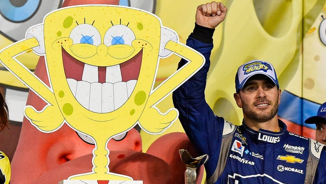 Jimmie Johnson celebrates after winning the Spongebob Squarepants 400 at Kansas Speedway.