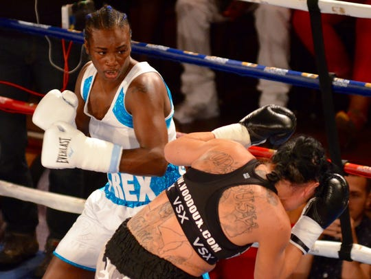 Claressa Shields, left, takes on Sydney LeBlanc in