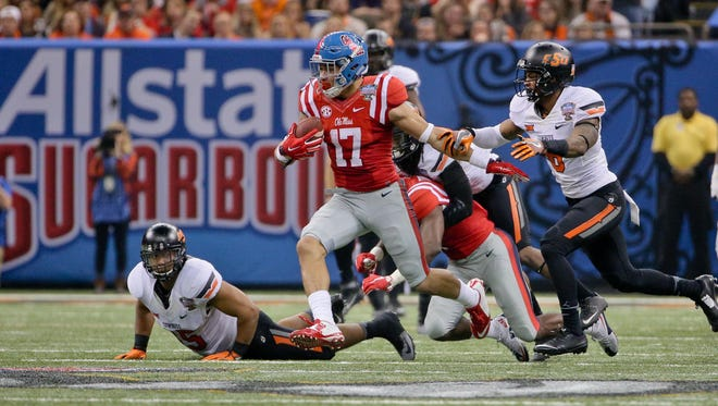 Evan Engram's decision to return for his senior season gives the Rebels a lift in 2016, but they've already gotten interest from two four-star recruits.