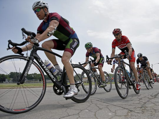 Men from the Master's 3/4 division round a corner Thursday during the Tour of America's Dairyland Neenah Rocket Criterium in Neenah.