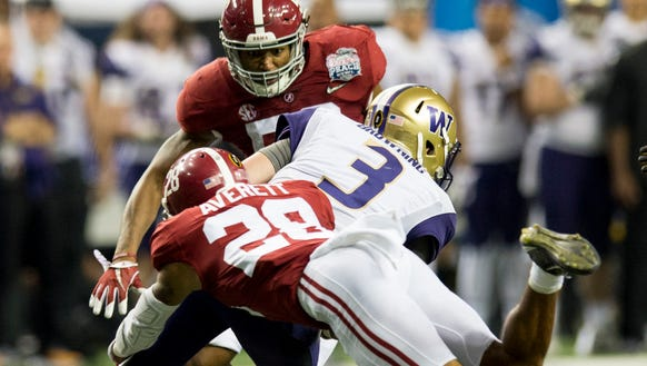 Alabama defensive back Anthony Averett (28) and linebacker