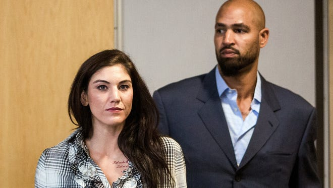 U.S. women's soccer star Hope Solo was with her husband, Jerramy Stevens, when he was ticketed for driving under the influence early Monday.