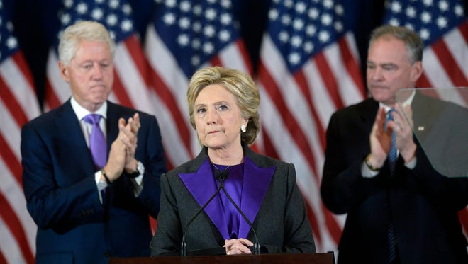 Hillary Clinton with Bill Clinton and Tim Kaine in New York City on Nov. 9, 2016.