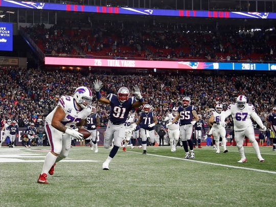 Dec 21, 2019; Foxborough, Massachusetts, USA; Buffalo Bills offensive tackle Dion Dawkins (73) catches a touchdown pass as New England Patriots defensive end Deatrich Wise (91) defends during the second quarter at Gillette Stadium. Mandatory Credit: Winslow Townson-USA TODAY Sports