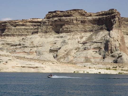A water craft jets past Warm Creek Bay at Lake Powell in the Spectrum file photo.