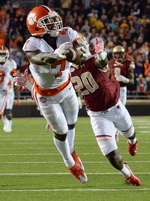Clemson wide receiver Mike Williams (7) catches a 50-yard pass past Boston College cornerback Isaac Yiadom (20) during the 1st quarter at Boston College's Alumni Stadium in Chestnut Hill, Mass. on Friday.