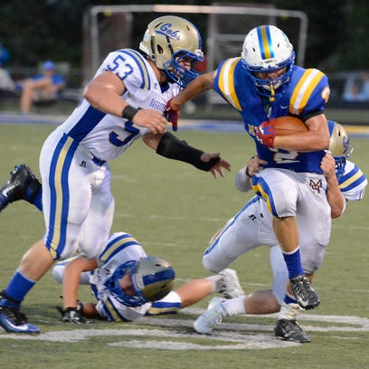 Bomber quarterback Zane Walker rushes for a gain.