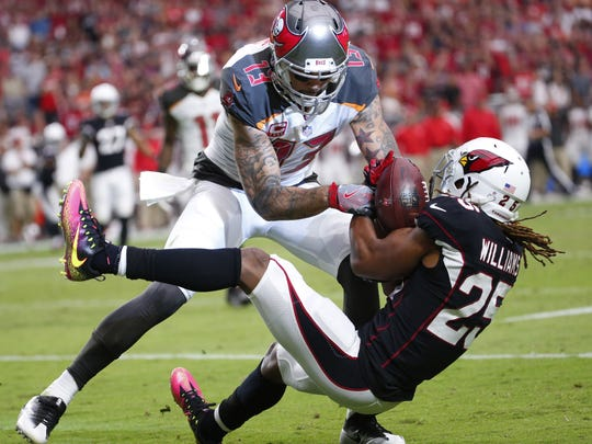 Cardinals defensive back Tramon Williams (25) intercepts a pass intended for Tampa Bay Buccaneers wide receiver Mike Evans (13) during the fourth quarter at University of Phoenix Stadium in Glendale, Ariz. October 15, 2017.