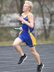 Whit Lawrence runs in the 4x800 relay.