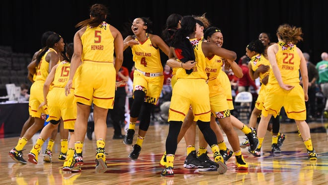 Maryland Terrapins guard Lexie Brown (4) reacts with her teammates after defeating the Ohio State Buckeyes to win the championship game of the Big Ten Tournament at the Sears Centre on March 8, 2015.
