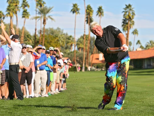 John Daly hits an approach shot on the 18th hole at La Quinta Country Club during the Humana Challenge on Thursday.