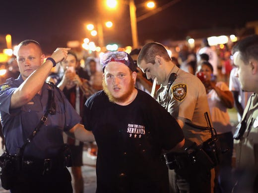 First relatively calm night in Ferguson since teen's death