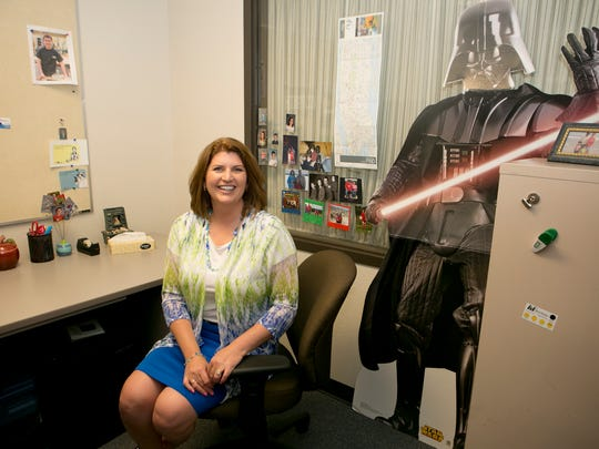 Debby Wallner sits at her desk next to her Darth Vader cutout in Wisconsin Rapids.