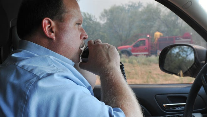 In this file photo, Wichita County Sheriff David Duke communicates with area fire agencies about a large grass fire.